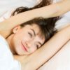 White sheets stretching eyes open smiling happy